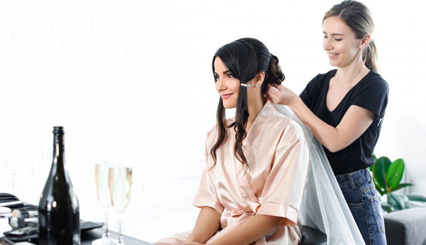 Wedding hair stylist and bride